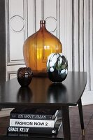 Coloured glass vases on vintage-style black table
