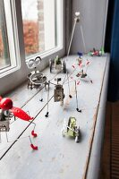Tiny, delicate sculptures on windowsill