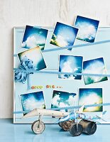 Photos of clouds on hand-made pinboard
