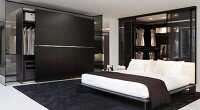 Black and white bedroom; double bed and black wardrobe with open sliding door