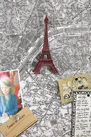 A map of Paris decorated with souvenirs and postcards