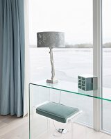 Plexiglas stool with seat cushions and purist glass table