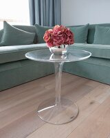 Corner sofa and small plexiglas Tulip table