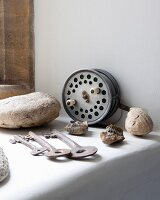 Vintage keys and fossils on masonry shelf