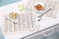 Place mats hand-made from sheet music