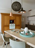 Lrge, Scandinavian dining table in kitchen integrated unobtrusively into living area