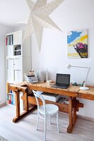 White Thonet chair at old workbench used as vintage-style desk