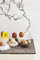 Balls of string, small, simple wicker basket and nest of feathers holding eggs
