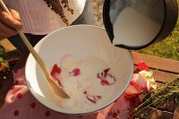 Milk and petals in bowl for making milk beauty treatment