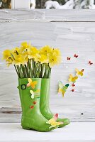 Wellington boots repurposed as spring vase & decorated with paper butterflies