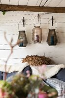 Lanterns hung on white-painted wooden wall