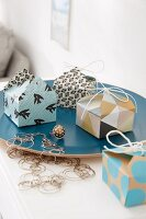 Homemade mini boxes made from decorative, double-sided paper for gifts