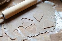Biscuit dough with cut-out love-hearts