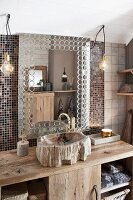 Rustic washstand with mosaic tiles and sink made from petrified wood