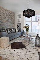 Brick wall and Oriental accessories in Scandinavian living room
