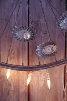 An old bicycle wheel decorated with brioche tends, fairy lights and Christmas baubles