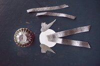 Angel's wings, a metal baking tin and silver ribbons for crafting