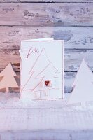 A homemade Christmas card decorated with paper Christmas trees
