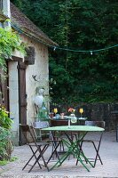 Metal garden furniture on terrace outside country house