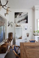 Rustic dining area, white vintage locker and hunting trophies on wall