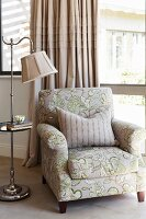 Armchair and vintage-style standard lamp