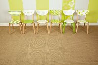 Simple wooden chairs revamped with patterns of fresh green paint