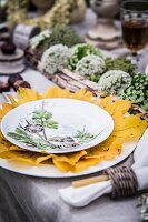 Autumnal arrangement of natural decorations on set table