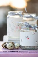 Screw-top jars decorated with floral pattern and quails' eggs