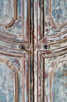 Antique wooden cabinet with peeling paint (detail)
