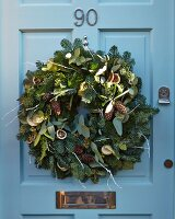 Advent wreath on blue front door