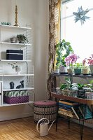 String shelves and plant stand in retro living room