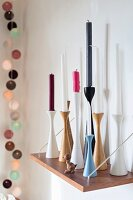 Candles of various colours in Scandinavian candlesticks
