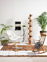 Classic chair, designer standard lamp, simple rocking chair and house plants