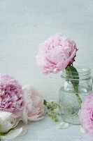 Peonies in vintage screw-top jars
