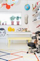 Desk, toys and musical instruments in teenager's bedroom