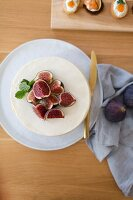 Cut figs on top of white cake