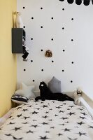Polka-dot wall in black and white child's bedroom