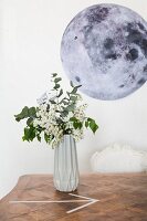 Geometric vase in front of picture of moon