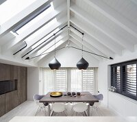 Dining room with exposed roof structure and beams