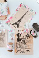Clippings from vintage French magazines and floral fabric accessories