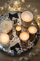 Sparkling silver arrangement of tealight holders and fairy lights on tray