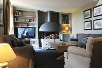 Open fireplace, comfortable seating and TV in cosy living room