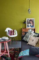 Colourful living room with mustard-yellow wall