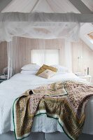 Romantic attic bedroom with board walls