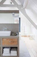 Attic bathroom with wooden floor and exposed roof beams