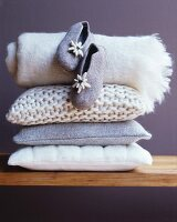 Cosy cushions, blanket and felt slippers