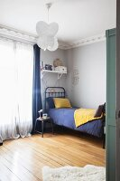 Vintage-style child's bedroom with stucco frieze and wooden floor