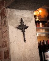 Wrought iron cross in stone doorway, Restaurant Charango, Cape Town, South Africa