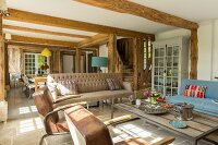 Pleasant, open-plan living area in restored half-timbered house with traditional ambiance