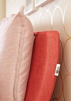 Back cushions attached to bed headboard with zips